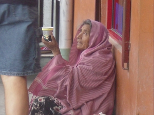 old woman begging