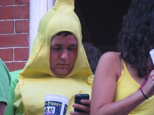 A walking banana on his cell.