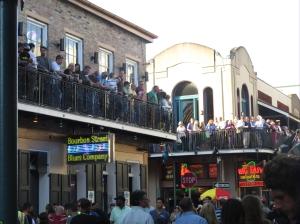 Balconies full of revelers watching the action below.