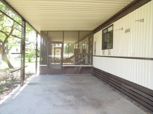 The screened patio and the carport